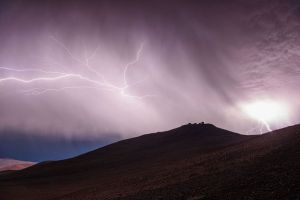 Rare lightning storm over Chile's VLT array (very large telescope) at 8,500ft Cerro Paranal, Atacama desert