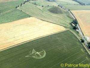 July 7th 2013 at first sign of English summer, largest manmade mound in Europe, Silbury Hill attracts Ship of Dreams crop circle